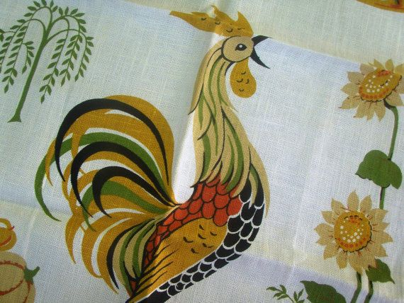 In mint with label , unused condition, this delightful Midcentury Modern vintage towel features a crowing rooster with farmhouse graphics of a bountiful harvest of fruits, pumpkins and gourd in lovely midcentury colors. Sunflowers, picket fence, wind vane, sheaves of wheat, watering can, grandfather clock, antique door hinge, bells complete the farmhouse chic theme. Lovely graphics in bold color handprinted on crisp, clean linen. Clean and ready for use or gifting. This would be lovely…
