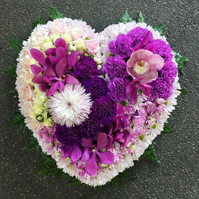A Heart Wreath including Orchids, Disbuds, Cymbidium, Carnations, Stock, Chysanthemum and Earlicheer