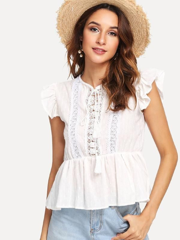 077028d77bdf9 Our Lover Lover Top features  High neck with ties and tassels Ruffle trim