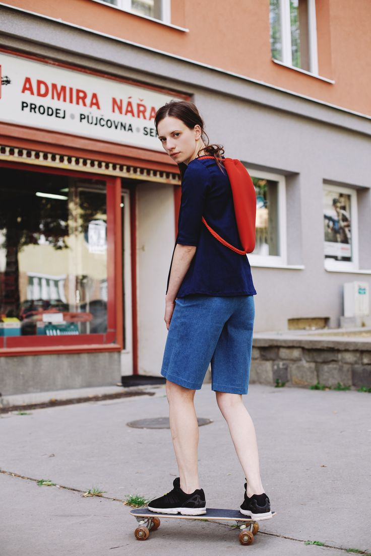 POKOJÍK / Tereza wears Pinwheels denim shorts, and Pinwheels denim blouse, on her back a backpack by Pavel Jevula