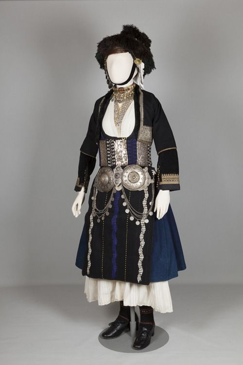 Bridal costume of Alexandria (Yidas), Imathia, Macedonia. Early 20th c. ©Peloponnesian Folklore Foundation. The bridal costume was worn in villages in the plain of Yannitsa. The bridal headdress is a katsoúli me tis foúndes: the katsoúli is the egg-shaped part of the headdress, held in place on the crown of the head by a lock of hair from married women. Wrapped round the katsoúli are three kerchiefs. One hangs down the back and is called the peristéra (dove).