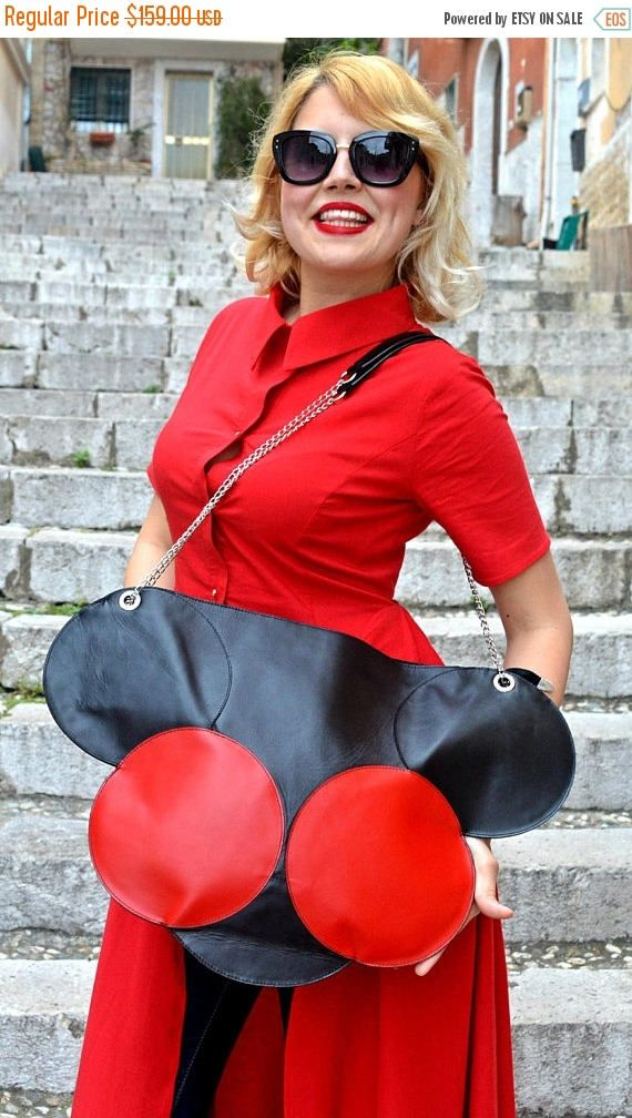 Extravagant black and red leather tote, large, practical and easy to wear. Multiple inside pockets. Funky and versatile, this leather bag will steal the spotlight and will jazz up any outfit! *black and red leather bag from the La Dolce Vita collection  Dimensions: length 50 cm(19,68 inches), height 38 cm ( 14,86 inches). Handle is 85 cm ( 33,46 inches)  Material: 100% genuine leather