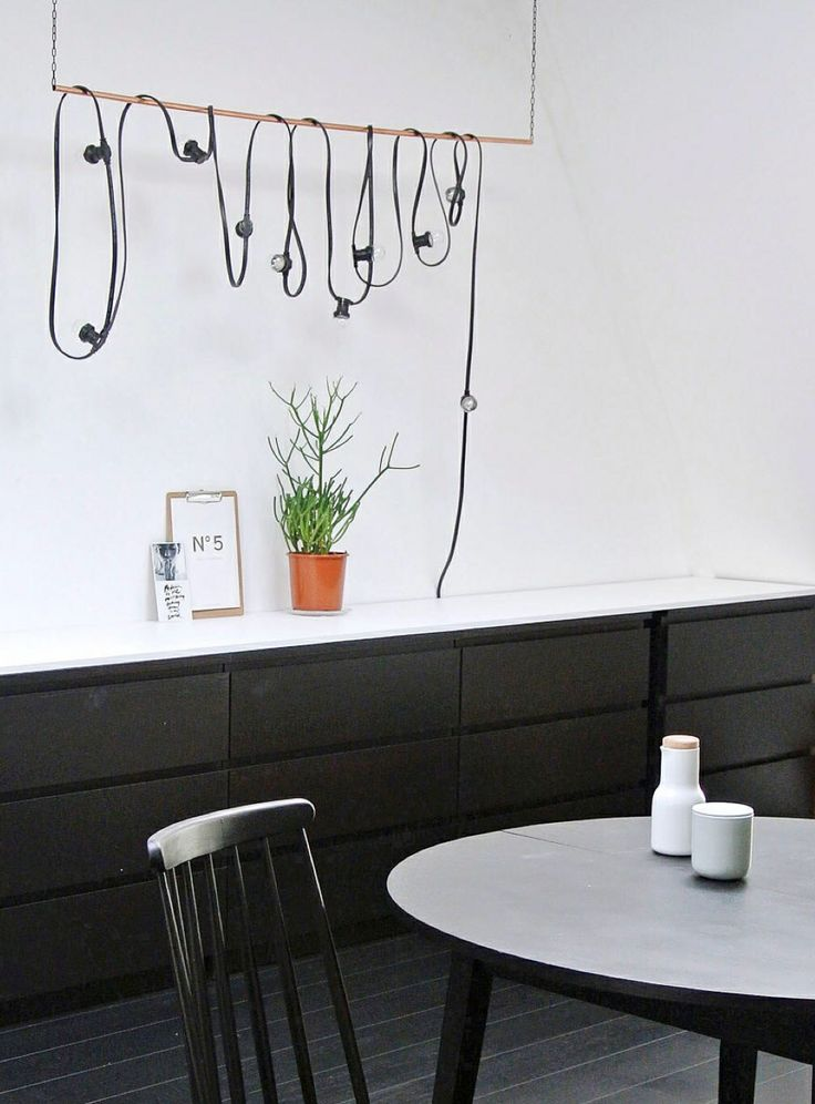 VT Wonen Magazine: White wall and countertop, black cupboards and floor. Maybe vice versa?