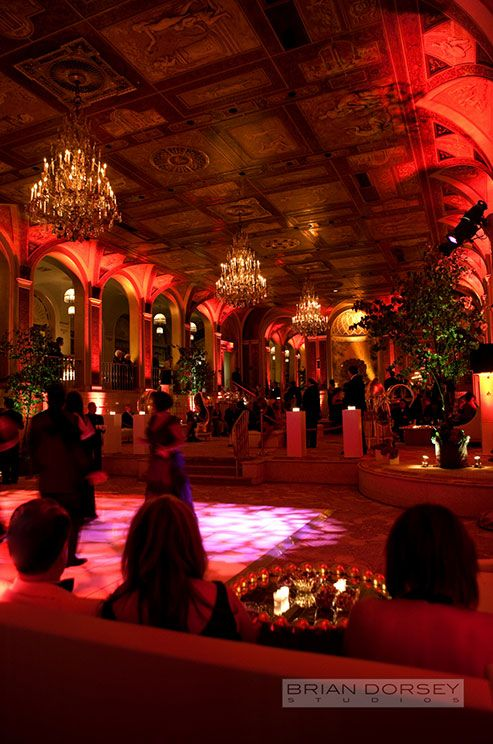 The Plaza Hotel in New York City is transformed into a chic red lounge for this exotic city wedding.