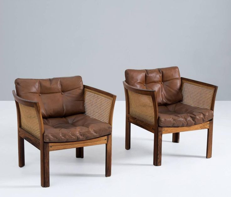 Pair of Lounge Chairs in Rosewood and Cane by Illum Wikkelsø | From a unique collection of antique and modern armchairs at https://www.1stdibs.com/furniture/seating/armchairs/
