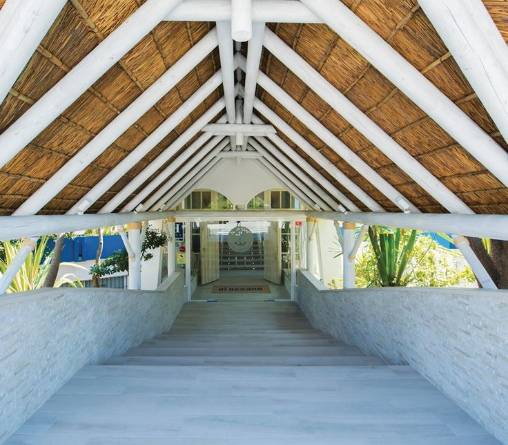 Whitewash thatched roof entrance at the magnificent El Oceano Hotel, Marbella, Spain!