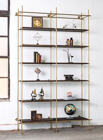 "2 Bay System Shelves in oxidized Oak, Framework in solid brass with a warm finish Bay Widths: (Center to Center) 36"" Size: 6'6"" W x 22"" D x 6'-6"" High"