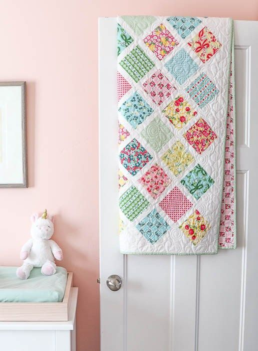 "Baby quilt tutorial - perfect for using 5"" charm squares. Learn a new quilting skill - how to sew together patchwork squares on point."