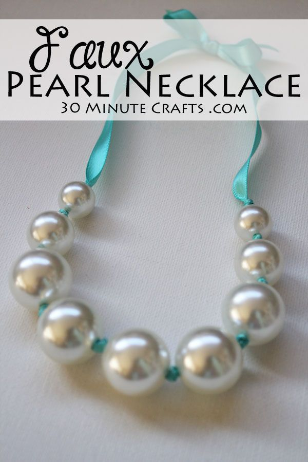 Faux Pearl Necklace - made with inexpensive beads and ribbon for a pop of color. No fancy jewelry making tools needed! #craft #cbloggers #bloggers #jewelry #beading