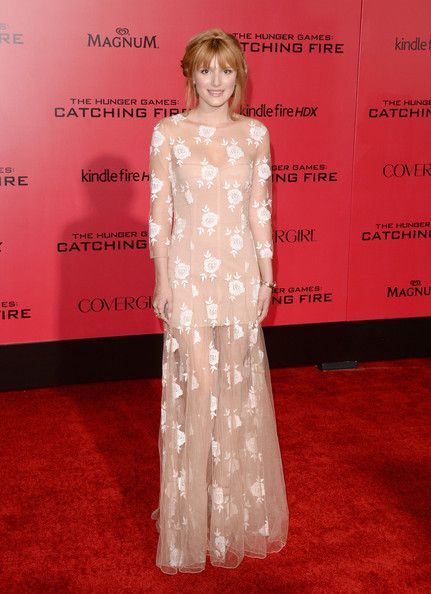 "Actress Bella Thorne arrives at the premiere of Lionsgate's ""The Hunger Games: Catching Fire"" at Nokia Theatre L.A. Live on November 18, 201..."