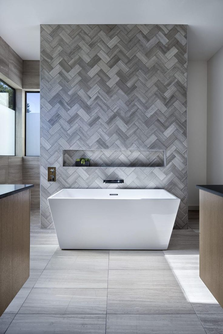 Love the herringbone tiled feature wall with the niche.