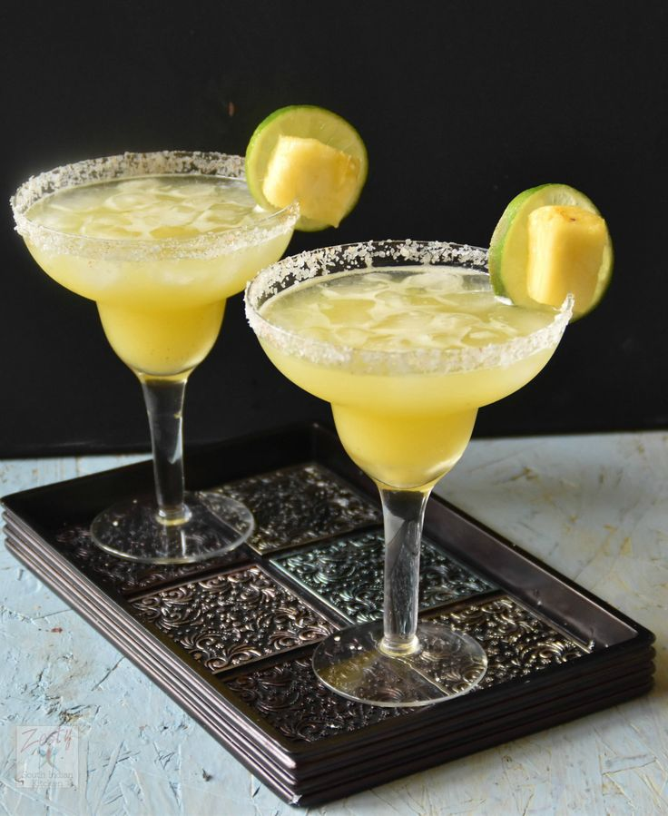 Here is the delicious no sugar added pineapple margarita with fresh pineapple juice, tequila, Triple sec, lime and lemon juice.
