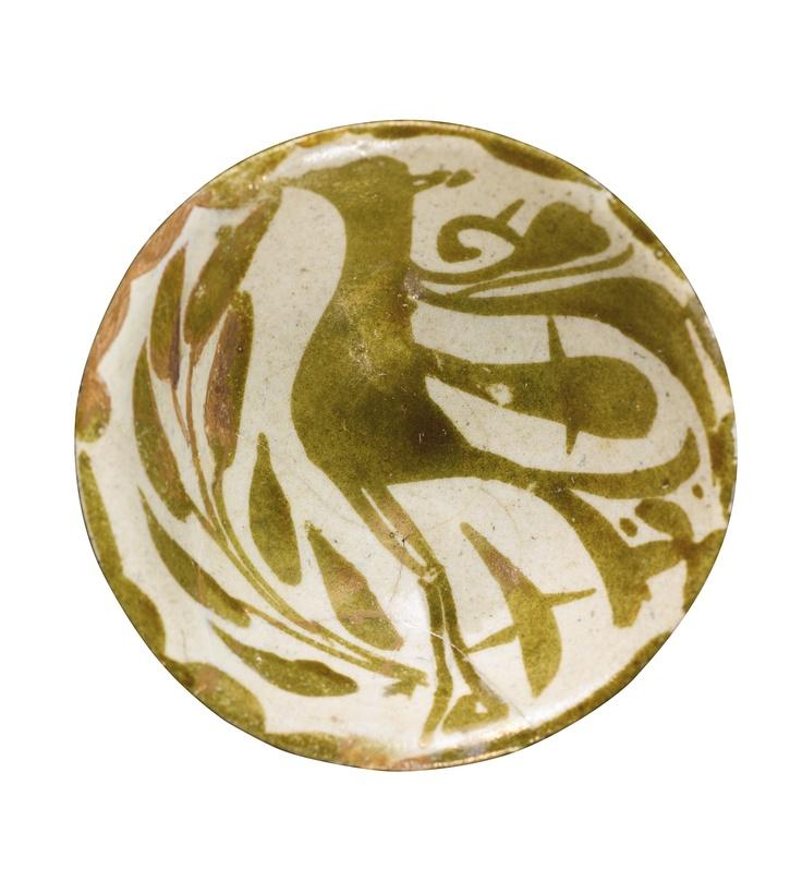 A FATIMID LUSTRE BOWL DEPICTING A BIRD IN FOLIAGE, EGYPT, 11TH-12TH CENTURY