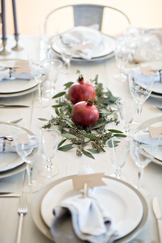 Beautiful Pomegranate Wedding Arrangements and Ideas | If you are aiming to stay minimalist with your approach to wedding décor, consider the simple beauty of a few vibrant pomegranates along with a spread of eucalyptus leaves. It's also something to remember when you're hosting your first few dinner parties as newlyweds!
