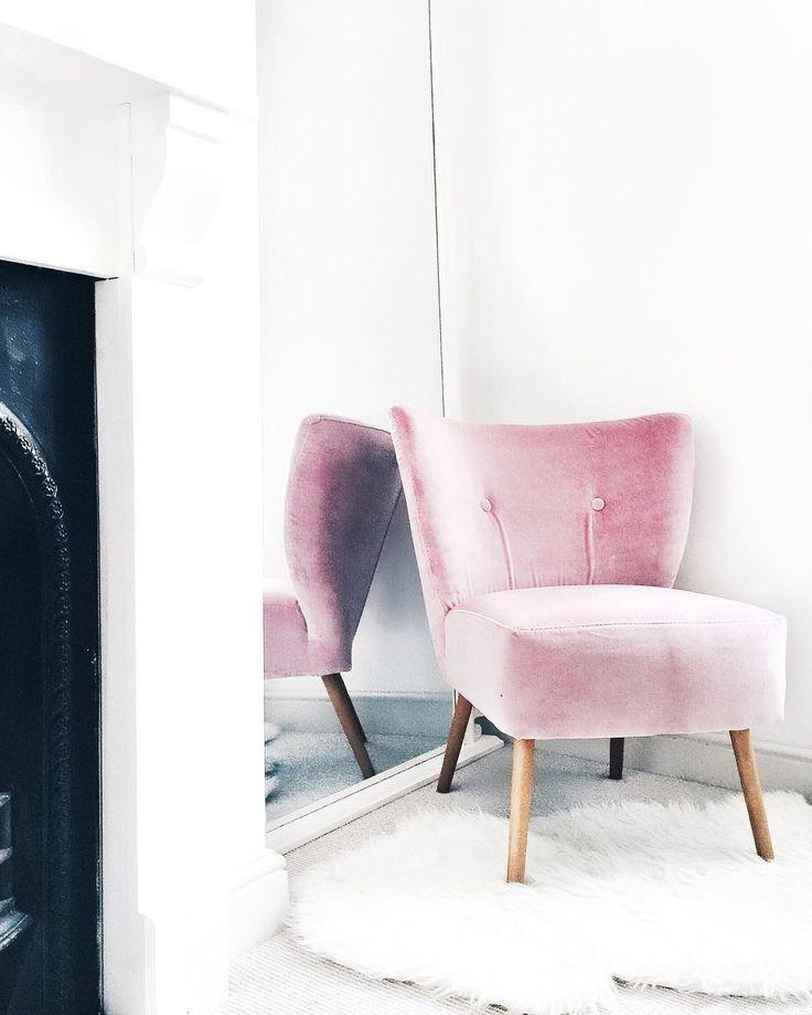 blush velvet chair and sheepskin rug