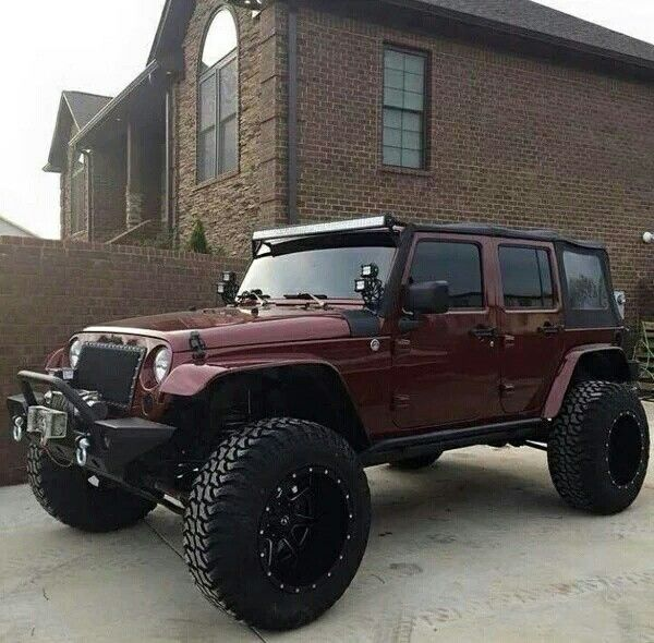 Lifted Burgundy Jeep