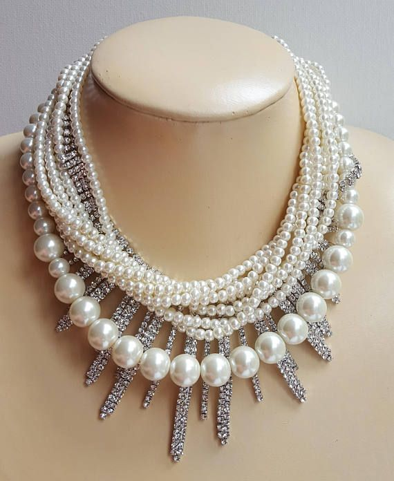 Check out this item in my Etsy shop https://www.etsy.com/ca/listing/526330660/multistrand-pearl-and-rhinestone