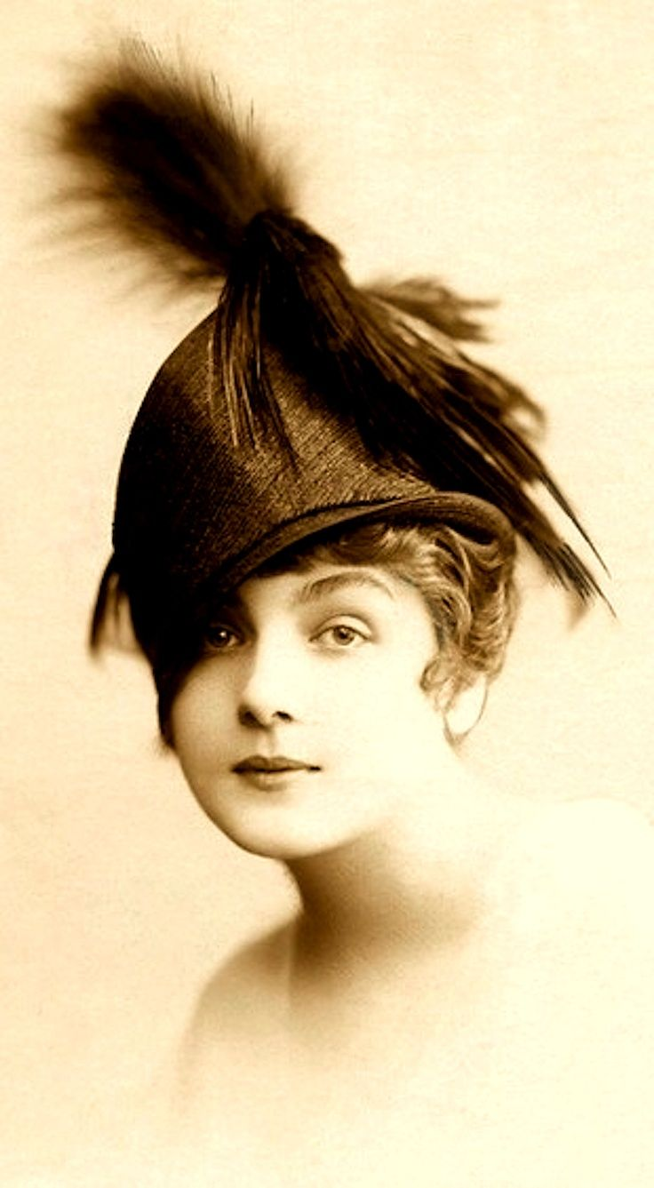 Feather in your cap. 1915 such a beautiful expression on her face -sww