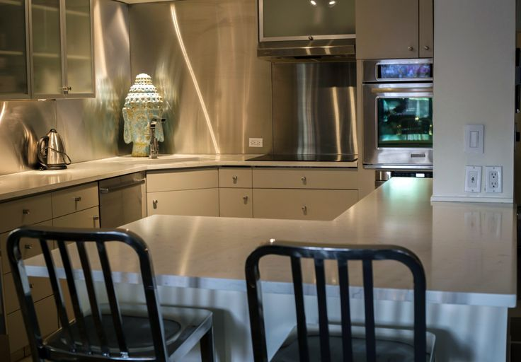 One of our #Calgary kitchen installations - removed all old countertops and eating bar and replaced with Vico Stone #Quartz countertop. www.empirestone.net