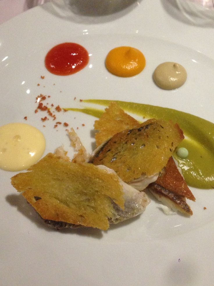 Fried small fish on thin slices of sourdough bread, with green pea cream, smoked eggplant mousse and a tomato-carrot jam by Lefteris Lazarou http://varoulko.gr/our-chef/