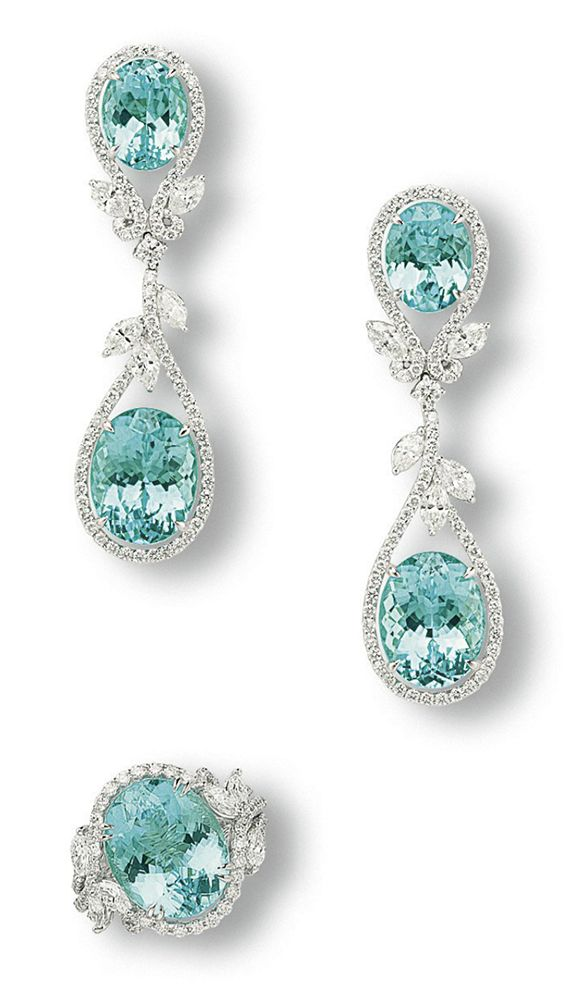 My late mother's birthstone color.  A SET OF TOURMALINE AND DIAMOND JEWELLERY Comprising a pair of ear pendants, each suspending an oval-shaped paraiba tourmaline weighing 7.87 or 6.94 carats, spaced by brilliant-cut diamond scrolls and marquise-cut diamond leaves, to the oval-shaped paraiba tourmaline surmount weighing 4.49 and 3.39 carats; and a ring set with an oval-shaped paraiba tourmaline weighing 8.37 carats en suite, all mounted in platinum, ring size 6, ear pendants 5.3 cm long