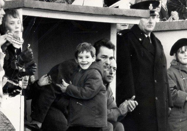 Brian Clough (Brighton & Hove Albion FC, 1973–1974) with his young son Nigel Clough in the dug-out at Brighton. After Derby County, Clough followed by taking in charge 3rd Division Brighton & Hove Albion during an eight-month spell, before Clough (but not Taylor) returned north in the summer of 1974 to become manager of Leeds United.