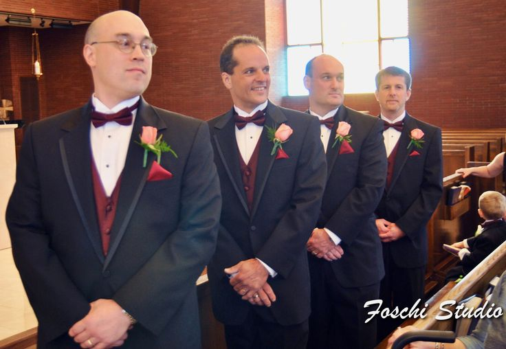 Tom's groomsmen wearing fashionable coral rose boutonnieres.