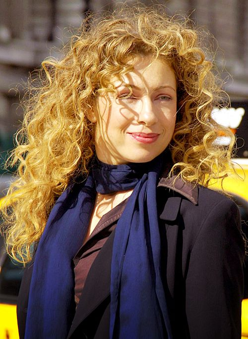 Alex Kingston aka River Song... Her outfit looks like Sherlock's 0.o As a side note, could her hair be any more gorgeous?!