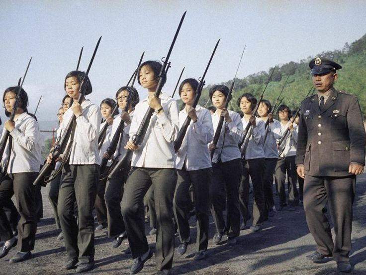 Once a week the students of the Ming Chuan College of Commerce for Girls have to line up for military drill in Taipei City, Taiwan (shown here in April 1972). The drills are commanded by a Chinese army officer. Until the girls graduate from school they have to dress in school uniforms and wear short government prescribed haircuts.