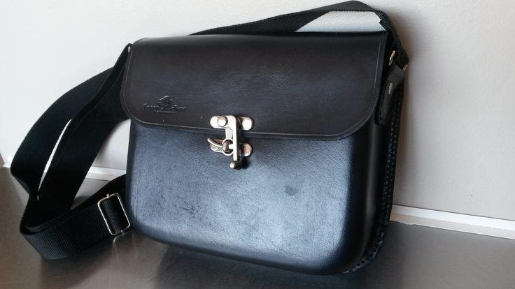 Moulded leather shoulder bag .