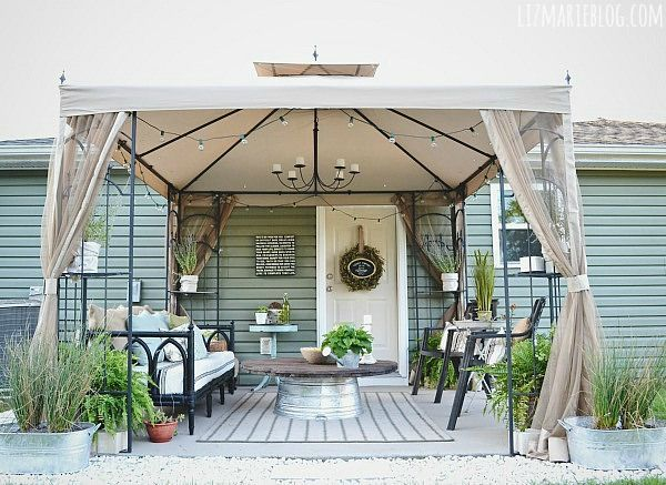 What a GREAT WAY to created a shady, outdoor family room!  :o)  .....  DIY wire spool & metal tub coffee table - lizmarieblog.com