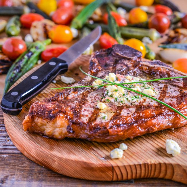 Grilled T-bone Steak with Blue Cheese, Bacon, and Chive Butter...serve this steak with grilled okra, Vidalia onions, and cherry tomatoes and you've got the perfect summer dinner.