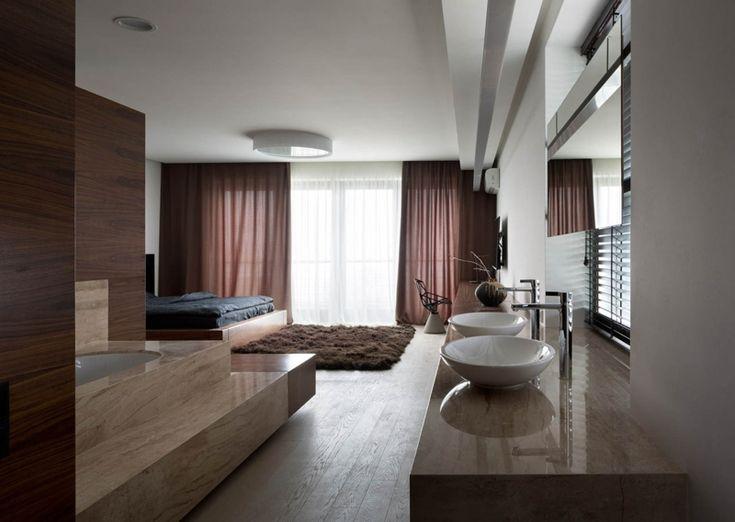 Luxus Schlafzimmer mit Badewanne von NOTT Design Studio