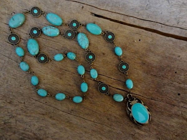 Cold enameled components and magnesite beads