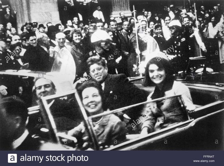 Download this stock image: JOHN F. KENNEDY (1917-1963). /n35th President of the United States. Kennedy and his wife, Jacqueline, with Texas Governor John Connally and his wife, Nellie, riding in an open car through Dallas, Texas, shortly before Kennedy's assasination on 22 November - FFRN4T from Alamy's library of millions of high resolution stock photos, illustrations and vectors.
