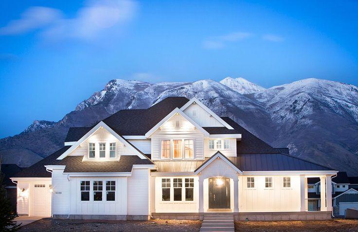 Exterior: modern farmhouse, white/light, non-obtrusive garage