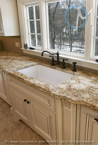 The dramatic veining of Yellow River is featured prominently in this kitchen.