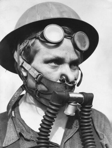 Styling Inspiration: Respiratory Protection  ----------------------------------------------- Female factory worker during WWII
