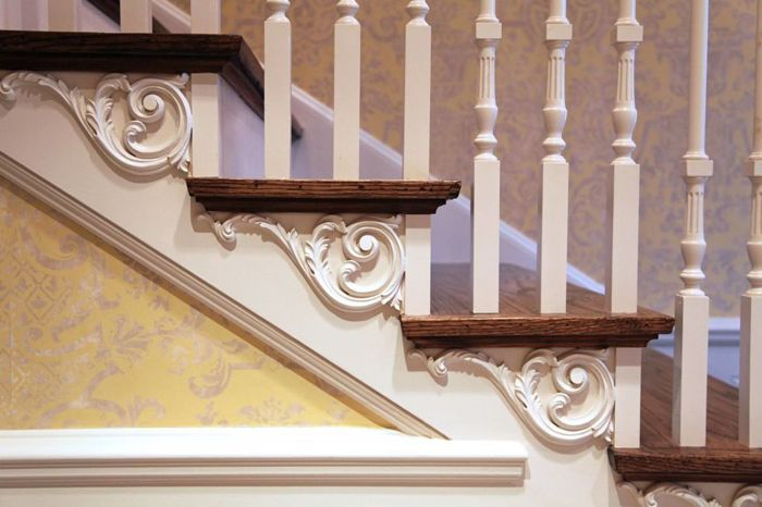 Used properly, ornament adds flair and a natural spark to a home. These decorative white-oak stair tread brackets offer visual support and substance to the stairs themselves. (Courtesy: Hull Historical)