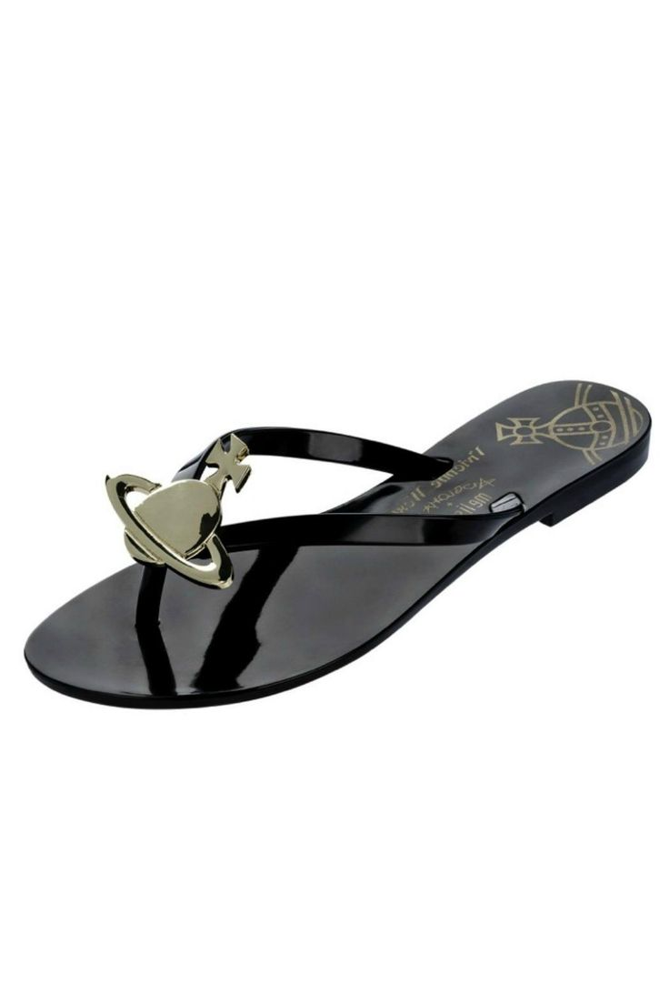 Vivienne Westwood  Melissa Harmonic Orb Flip Flops in black. Featuring a gold orb logo adornment and a printed padded footbed. Made from super soft and easy to clean Melflex plastic. These gorgeous flip flops are the perfect poolside accessory. Wear with a kaftan and a floppy hat for a chic holiday look.  Orb Flip Flops by Vivienne Westwood/Melissa. Shoes - Sandals - Flip Flops Essex East of England England United Kingdom