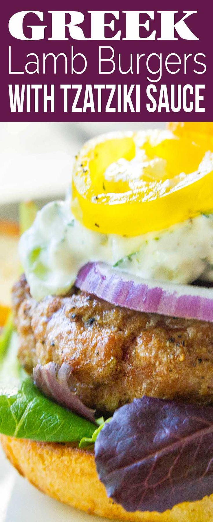 Grilled lamb burgers with homemade tzatziki cucumber sauce! Top with feta, sliced tomato, lettuce, and red onion. Easy summer cook-out recipe.