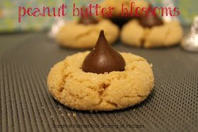 Peanut Butter Blossoms: Just in time for the holidays, this peanut buttery cookie is rolled in sugar and topped with a kiss! #cookies #peanutbutter #chocolate #dessert
