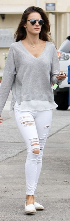 Alessandra Ambrosio: Sunglasses – Quay  Jeans – Frame  Necklace – Jennifer Meyer  Sweater – Feel the Piece