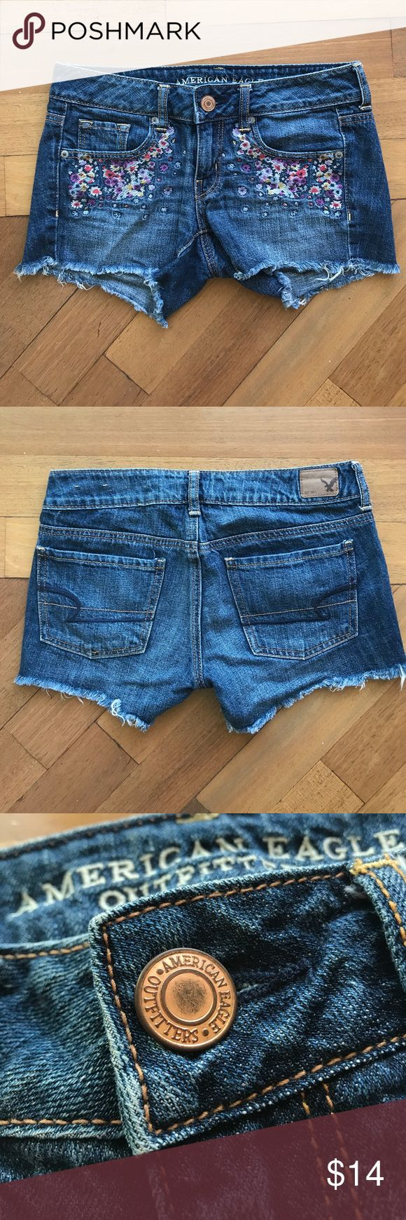 American Eagle jean embroidered shorts American Eagle dark wash jean shorts with floral embroidered front pockets and fringe bottom. Size 2. American Eagle Outfitters Shorts Jean Shorts