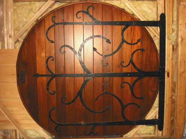 Round wood door with iron detail for all you Tolkien fans out there.