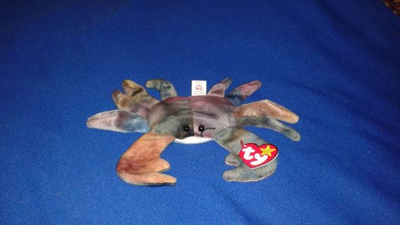 Check out this item in my Etsy shop https://www.etsy.com/listing/253320133/claude-the-crab-ty-original-beanie-baby