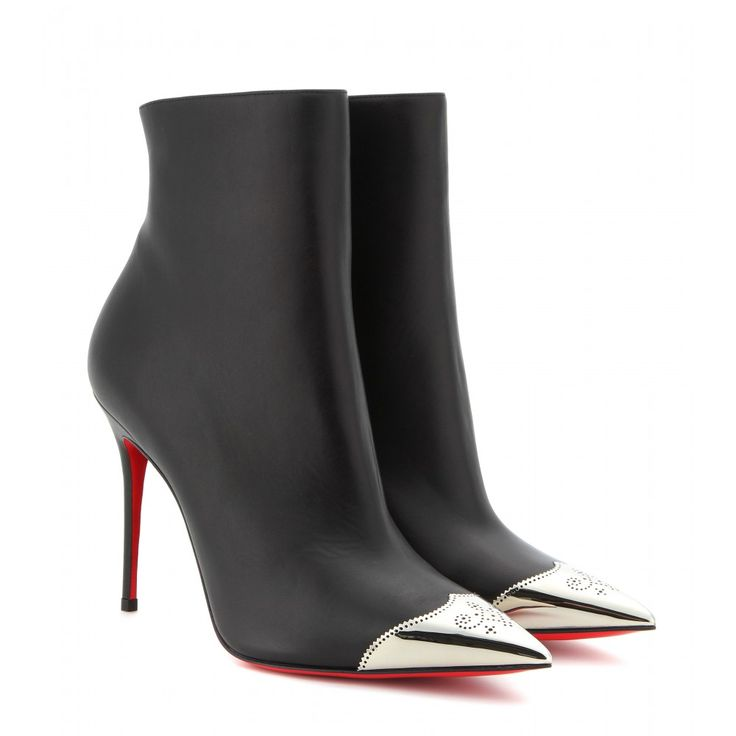 Stand out from the rest with Christian Louboutin's perforated silver-capped ankle  boots. The smooth black leather, sleek pin heel and pointed design stay ...