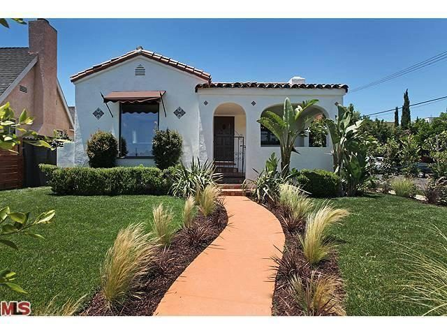 1920s SPANISH REVIVAL BUNGALOW (This house closely resembles ours! Though, I don't think we'll add an awning. I'd much rather have shutters... Curb appeal/landscape inspiration; add pavers as a border for the walkway)