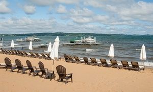 Groupon - Stay at Grand Beach Resort Hotel in Traverse City, MI. Dates into May. in Traverse City, MI. Groupon deal price: $62
