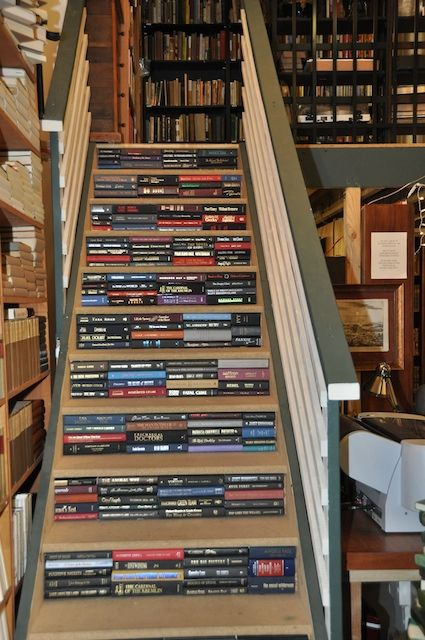 Book spines glued onto the risers of a staircase, Juniper Books LLC, 1001 Lee Hill Drive Suite 8, Boulder, Colorado